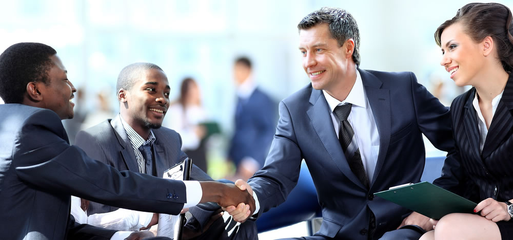 Shaking hands in a business environment